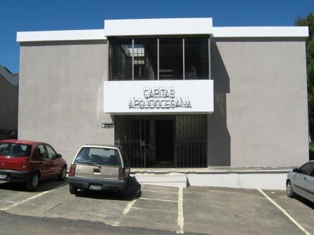 Caritas Arquidiocesana se encuentra en la 12 calle, 1-96, Colonia El Rosario, zona 3 de Mixco, Guatemala